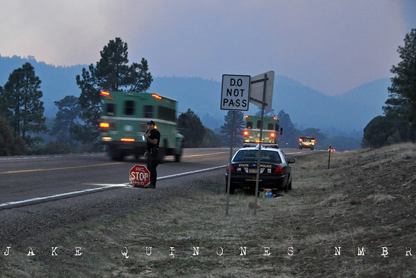 A New Mexico State Policeman directs fire traffic on Highway 180 near the NM/AZ state line, one mile west of Luna, NM- Catron County, NM