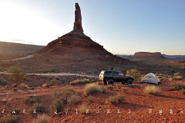As the sun sank in the cloudless sky, we entered Utah near Boundary Butte. After crossing over the San Juan River, the road to Valley of the Gods meanders between sheer red rock cliffs and smooth sandstone formations. The scenery became more spectacular with each passing mile. The vibration of the road lulled the little put to sleep. With each bend in the road, her eyes would flicker open and shut. - Valley of the Gods, UT