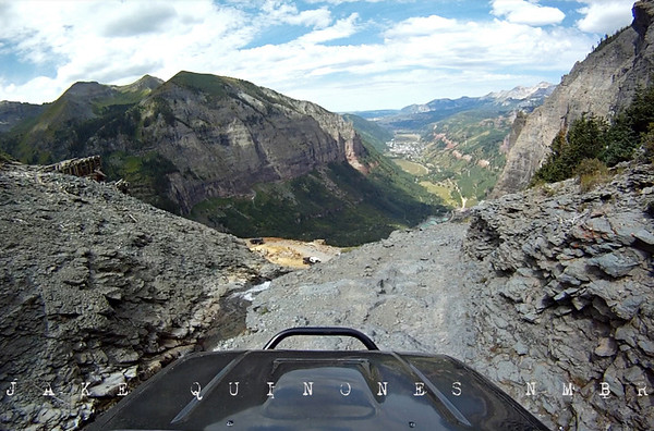 Black Bear Pass - Staring down the face of a sheer cliff, wheels locked and feeling the truck slide towards the edge&#8212;what a rush of blood to the head. It seems like a 5,000 lb. truck is easily hypnotized by gravity in precarious situations. Once in awhile, I have to put the camera down, and both hands on the wheel. View from the GoPro HD - San Juan Mountains, CO