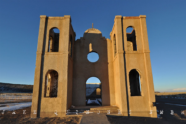 New Year's Day 2011 - After sunset, we stopped at San Isadore Church located in the tiny hamlet of Las Mesitas, Colorado. The church was gutted by a fire in the 1970&#8217;s and has remained unchanged since. The Conejos River, surrounding snow capped mountains and golden grass of the San Luis Valley provides a spectacular backdrop for the church remains. - Las Mesitas, CO